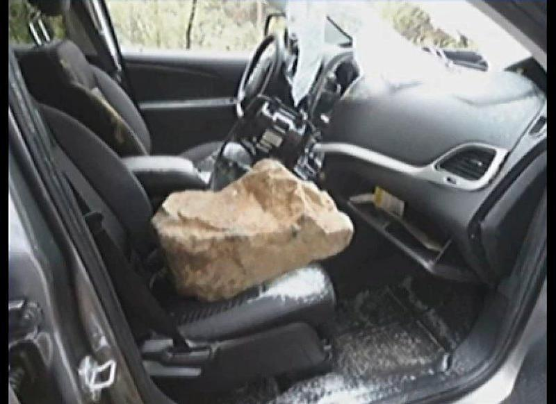 This 150-lb boulder crashed through the windshield of a rental car in Sedona, Az. The passengers, Bob Jaczko and Peter Wilson suffered minor cuts.