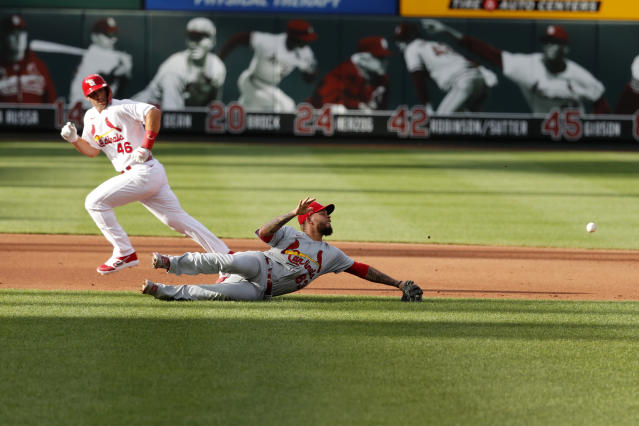 St. Louis Cardinals' Paul Goldschmidt (46) watches as a ball hit by Paul DeJong gets past infielder Edmundo Sosa for a two-run single during an intrasquad practice baseball game at Busch Stadium Thursday, July 9, 2020, in St. Louis. (AP Photo/Jeff Roberson)