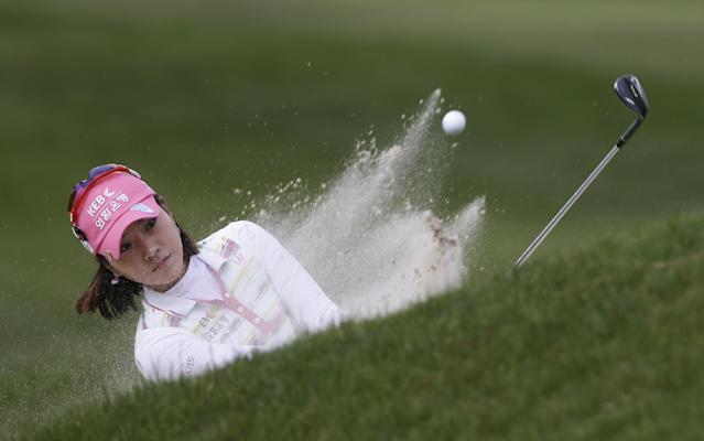 Hee Young Park, of South Korea, hits out of the bunker on the ninth green during the final round of the Kingsmill Championship golf tournament at the Kingsmill resort in Williamsburg, Va., Sunday, May 18, 2014. (AP Photo/Steve Helber)