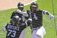 Chicago White Sox's Yoan Moncada, right, celebrates with Yermin Mercedes (73) and Tim Anderson, center, after hitting a two-run home run during the sixth inning of the first baseball game of a doubleheader against the Baltimore Orioles, Saturday, May 29, 2021, in Chicago. (AP Photo/Matt Marton)