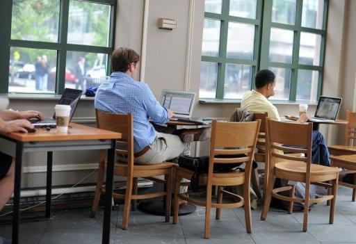 People use their laptop computers in Washington, DC. The Internet is set for a major upgrade in the coming week, but if all goes well, users won't even know it's happening