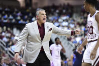 South Carolina coach Frank Martin yells to A.J. Lawson (00) during the first half of the team's NCAA college basketball game against Kentucky on Wednesday, Jan. 15, 2020, in Columbia, S.C. (AP Photo/Sean Rayford)
