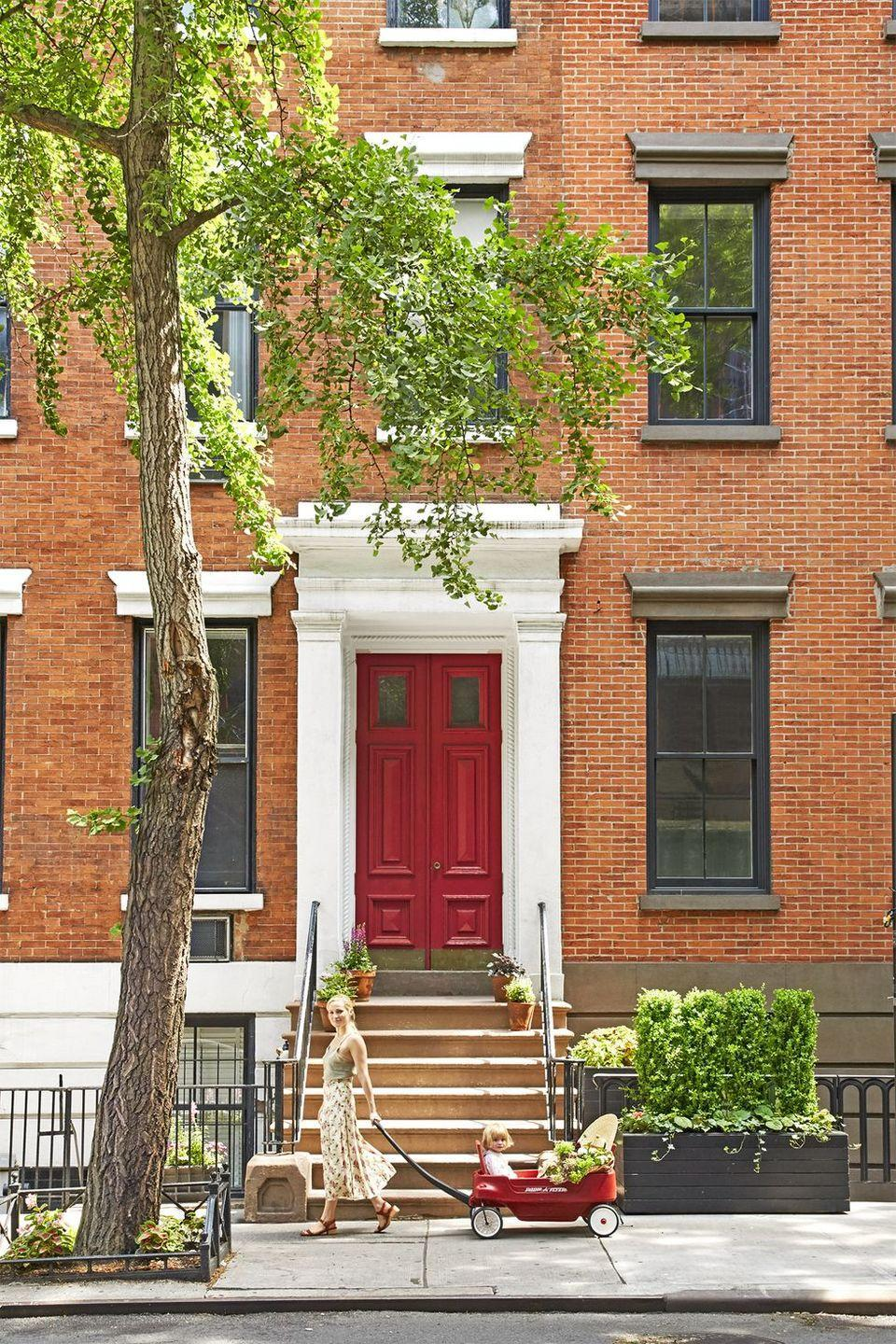 """<p>Your home will be the envy of your neighbors by painting your front door a sleek shade that complements its ornate exterior.</p><p><a class=""""link rapid-noclick-resp"""" href=""""https://store.benjaminmoore.com/storefront/color-samples/paint-color-samples-1-pint/prodPRM01A.html?sbcColor=2004_10"""" rel=""""nofollow noopener"""" target=""""_blank"""" data-ylk=""""slk:SHOP RED PAINT"""">SHOP RED PAINT</a></p>"""
