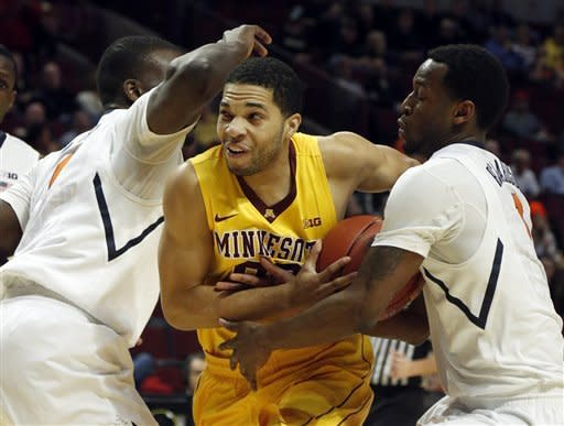 Minnesota's Julian Welch drives between Illinois' D.J. Richardson, right, and Sam McLaurin during the first half of an NCAA college basketball game at the Big Ten tournament Thursday, March 14, 2013, in Chicago. (AP Photo/Charles Rex Arbogast)