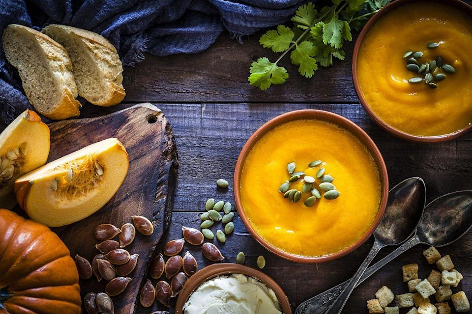 """<p>You <em>could</em> go to your local coffee shop for pumpkin spice lattes—or you could make an three-course, pumpkin-themed dinner. Kick off the evening with <a href=""""https://pinchofyum.com/roasted-garlic-rosemary-pumpkin-hummus"""" rel=""""nofollow noopener"""" target=""""_blank"""" data-ylk=""""slk:roasted garlic and rosemary pumpkin hummus"""" class=""""link rapid-noclick-resp"""">roasted garlic and rosemary pumpkin hummus</a>, <a href=""""https://www.foodnetwork.com/fnk/recipes/pumpkin-crostini-with-goat-cheese-and-balsamic-glaze-9541960"""" rel=""""nofollow noopener"""" target=""""_blank"""" data-ylk=""""slk:pumpkin crostini"""" class=""""link rapid-noclick-resp"""">pumpkin crostini</a>, or tried-and-true <a href=""""https://www.thepioneerwoman.com/food-cooking/recipes/a10399/pumpkin-soup/"""" rel=""""nofollow noopener"""" target=""""_blank"""" data-ylk=""""slk:pumpkin soup"""" class=""""link rapid-noclick-resp"""">pumpkin soup</a>, before whipping up <a href=""""https://www.delish.com/cooking/recipe-ideas/a28556182/pumpkin-ravioli-recipe/"""" rel=""""nofollow noopener"""" target=""""_blank"""" data-ylk=""""slk:pumpkin ravioli"""" class=""""link rapid-noclick-resp"""">pumpkin ravioli</a>, <a href=""""https://pinchofyum.com/pumpkin-gnocchi"""" rel=""""nofollow noopener"""" target=""""_blank"""" data-ylk=""""slk:pumpkin gnocchi"""" class=""""link rapid-noclick-resp"""">pumpkin gnocchi</a>, or <a href=""""https://www.howsweeteats.com/2019/10/pumpkin-cacio-e-pepe/"""" rel=""""nofollow noopener"""" target=""""_blank"""" data-ylk=""""slk:pumpkin cacio e pepe"""" class=""""link rapid-noclick-resp"""">pumpkin cacio e pepe</a> for a main course. Then top off your meal with <a href=""""https://sallysbakingaddiction.com/pumpkin-cheesecake/"""" rel=""""nofollow noopener"""" target=""""_blank"""" data-ylk=""""slk:a pumpkin swirl cheesecake"""" class=""""link rapid-noclick-resp"""">a pumpkin swirl cheesecake</a>, <a href=""""https://www.browneyedbaker.com/pumpkin-whoopie-pies-maple-cream-cheese-frostin/"""" rel=""""nofollow noopener"""" target=""""_blank"""" data-ylk=""""slk:pumpkin whoopie pies"""" class=""""link rapid-noclick-resp"""">pumpkin whoopie pies</a>, or <a href=""""https://www.halfbakedharvest.co"""