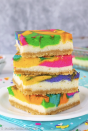 """<p>If your definition of rainbow involves neon colors, then these cheesecake bars are for you! Top them with whipped cream and rainbow sprinkles for an extra burst of color.</p><p><strong>Get the recipe at <a href=""""https://insidebrucrewlife.com/rainbow-vanilla-cheesecake-bars/"""" rel=""""nofollow noopener"""" target=""""_blank"""" data-ylk=""""slk:Inside BruCrew Life"""" class=""""link rapid-noclick-resp"""">Inside BruCrew Life</a>.</strong></p><p><strong><a class=""""link rapid-noclick-resp"""" href=""""https://go.redirectingat.com?id=74968X1596630&url=https%3A%2F%2Fwww.walmart.com%2Fsearch%2F%3Fquery%3Dhand%2Bmixer&sref=https%3A%2F%2Fwww.thepioneerwoman.com%2Ffood-cooking%2Fmeals-menus%2Fg36421919%2Frainbow-recipes%2F"""" rel=""""nofollow noopener"""" target=""""_blank"""" data-ylk=""""slk:SHOP HAND MIXERS"""">SHOP HAND MIXERS</a><br></strong></p>"""