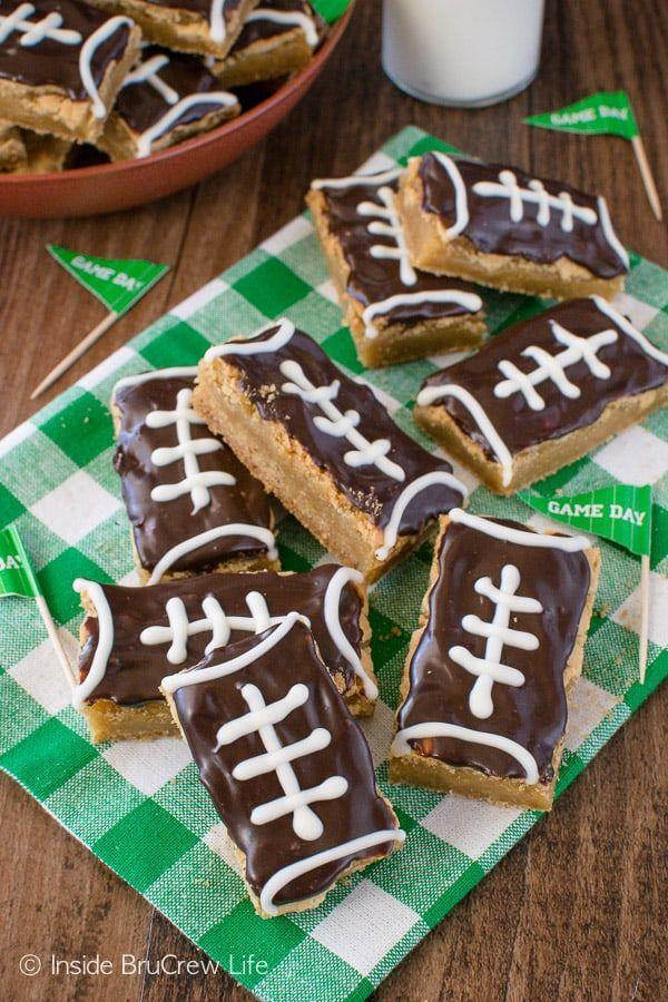 """<p>Cookie bars are easy to serve to a large crowd, and this recipe is ideal for a hungry gathering of football fans.</p><p><strong>Get the recipe at <a href=""""https://insidebrucrewlife.com/football-cookie-bars/"""" rel=""""nofollow noopener"""" target=""""_blank"""" data-ylk=""""slk:Inside BruCrew Life"""" class=""""link rapid-noclick-resp"""">Inside BruCrew Life</a>.</strong></p><p><strong><strong><a class=""""link rapid-noclick-resp"""" href=""""https://www.amazon.com/Hamilton-Beach-62682RZ-Mixer-Snap/dp/B001CH0ZLE/?tag=syn-yahoo-20&ascsubtag=%5Bartid%7C10050.g.5080%5Bsrc%7Cyahoo-us"""" rel=""""nofollow noopener"""" target=""""_blank"""" data-ylk=""""slk:SHOP HAND MIXERS"""">SHOP HAND MIXERS</a></strong><br></strong></p>"""