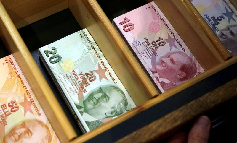 FILE PHOTO: Turkish lira banknotes are pictured at a currency exchange office in Istanbul