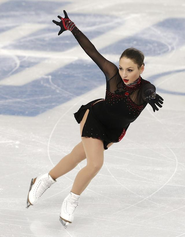 Elene Gedevanishvili of Georgia competes in the women's short program figure skating competition at the Iceberg Skating Palace during the 2014 Winter Olympics, Wednesday, Feb. 19, 2014, in Sochi, Russia. (AP Photo/Darron Cummings)
