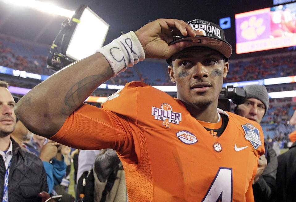 FILE - In this Dec. 6, 2015, file photo, Clemson quarterback Deshaun Watson celebrates after Clemson defeated North Carolina 45-37 in the Atlantic Coast Conference championship NCAA college football game in Charlotte, N.C. Watson and the Tigers are the preseason favorites to win the ACC. (AP Photo/Gerry Broome, File)