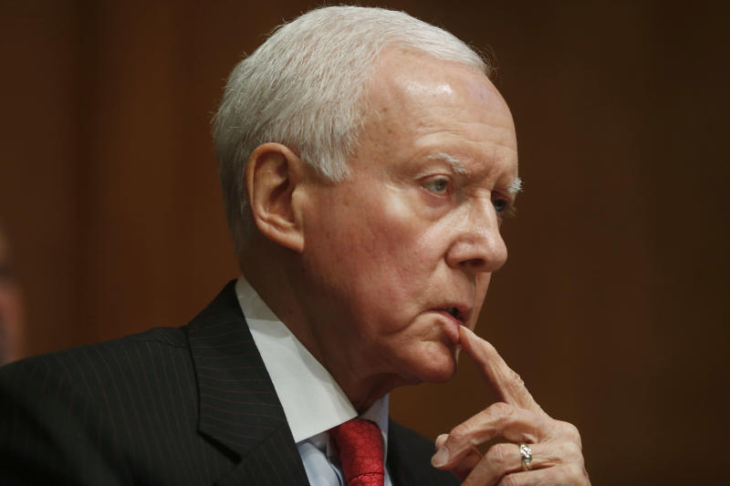 """In this photo taken May 21, 2013, Senate Finance Committee ranking member, Republican Sen. Orrin Hatch of Utah, listens to testimony at the committee's hearing on the IRS's targeting of applicants for tax exempt status. """"The bottom line here is that the IRS can barely manage what it already has to do, and that's a generous characterization given the targeting of conservative groups,"""" said Hatch, whose committee oversees the IRS. """"Adding Obamacare under the IRS, that can only be described as a looming disaster,"""" he said. """"And now the Democrats are saying we need to give the IRS more money. I'm not sure I'm willing to do that."""" (AP Photo/Charles Dharapak)"""