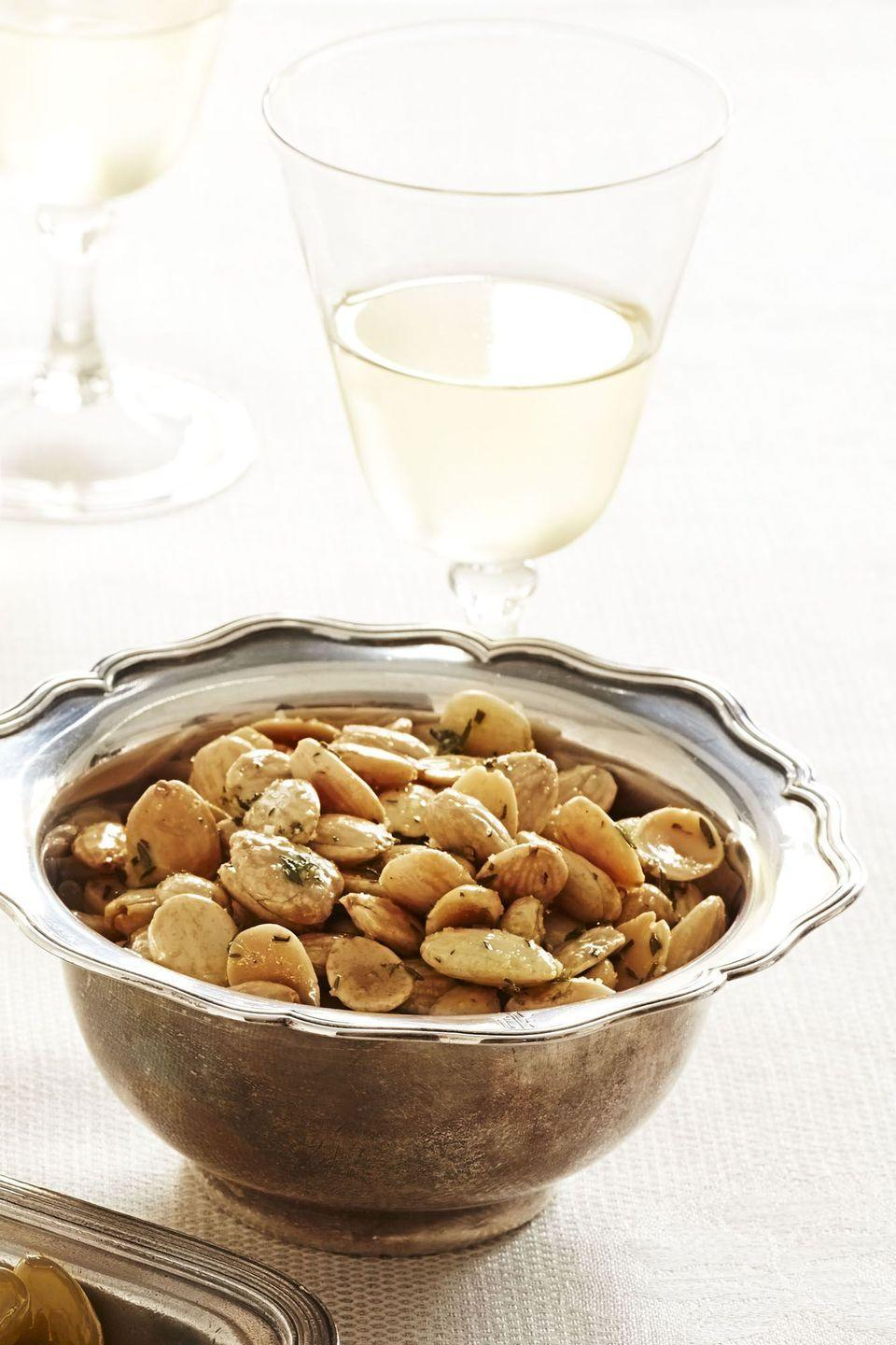 "<p>These salty and herby nuts are the perfect snack to munch on while you wait for your turkey to finish roasting.</p><p><em><a href=""https://www.goodhousekeeping.com/food-recipes/a11589/thyme-roasted-marcona-almonds-recipe-ghk1113/"" rel=""nofollow noopener"" target=""_blank"" data-ylk=""slk:Get the recipe for Thyme-Roasted Marcona Almonds »"" class=""link rapid-noclick-resp"">Get the recipe for Thyme-Roasted Marcona Almonds »</a></em></p><p><strong>RELATED: </strong><a href=""https://www.goodhousekeeping.com/holidays/thanksgiving-ideas/g1379/make-ahead-thanksgiving-appetizers/"" rel=""nofollow noopener"" target=""_blank"" data-ylk=""slk:28 Amazing Make-Ahead Thanksgiving Appetizers"" class=""link rapid-noclick-resp"">28 Amazing Make-Ahead Thanksgiving Appetizers</a></p>"