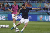 Italy's Jorginho warms up ahead of the Euro 2020 soccer championship group A match between Italy and Turkey at the Olympic stadium in Rome, Friday, June 11, 2021. (Alberto Lingria/Pool Photo via AP)