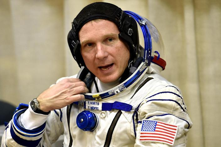 US astronaut Terry Virts speaks as his space suit is tested prior to blasting off to the International Space Station (ISS) on November 23, 2014 (AFP Photo/Kirill Kudryavtsev)