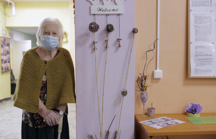 An elderly woman waits to receive a dose of the COVID-19 vaccine, at Nadezhda nursing home, in Sofia, Wednesday, Jan. 27, 2021. Bulgaria began vaccinating elderly people on Wednesday. (AP Photo/Valentina Petrova)