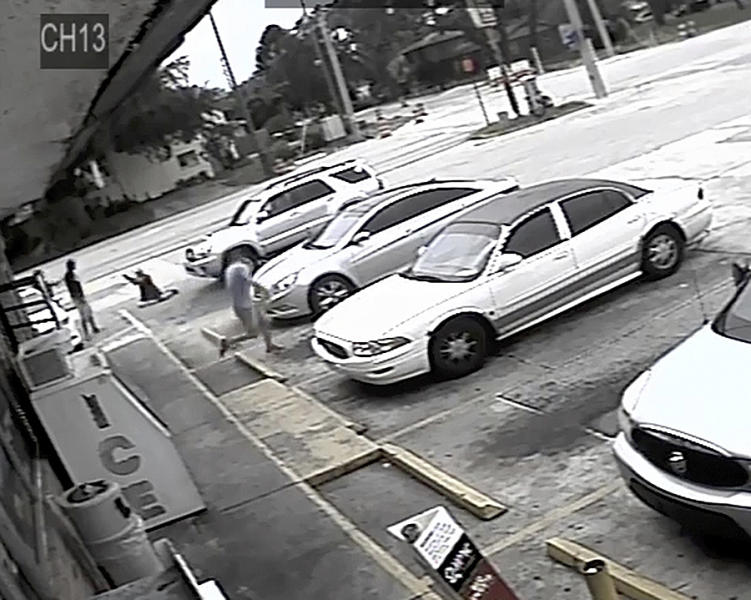 In this Thursday, July 19, 2018 image taken from surveillance video released by the Pinellas County Sheriff's Office, Markeis McGlockton, far left, is shot by Michael Drejka during an altercation in the parking lot of a convenience store in Clearwater, Fla. The family of McGlockton issued an appeal Tuesday, July 24, 2018, through an attorney for the public to put pressure on State Attorney Bernie McCabe to file charges against Drejka, a white man who fatally shot the black father of three last Thursday upon being pushed to the ground outside a convenience store. (Pinellas County Sheriff's Office via AP)