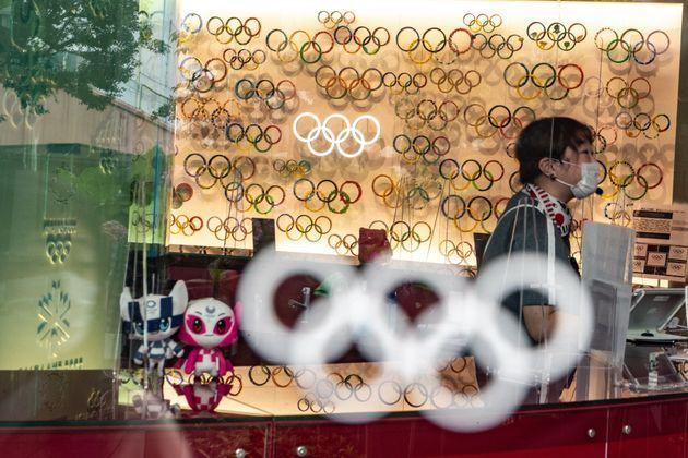 TOPSHOT - An employee is seen among Olympic Rings and Tokyo 2020 mascots at the Japan Olympic Museum in Tokyo on July 8, 2021. (Photo by Philip FONG / AFP) (Photo by PHILIP FONG/AFP via Getty Images) (Photo: PHILIP FONG via Getty Images)