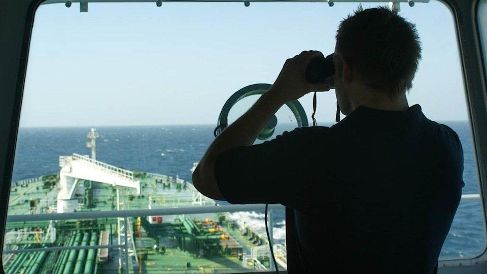 Keeping watch: a British security guard on the bridge of a merchant tanker off the coast of Oman during the height of the Somali piracy threat.