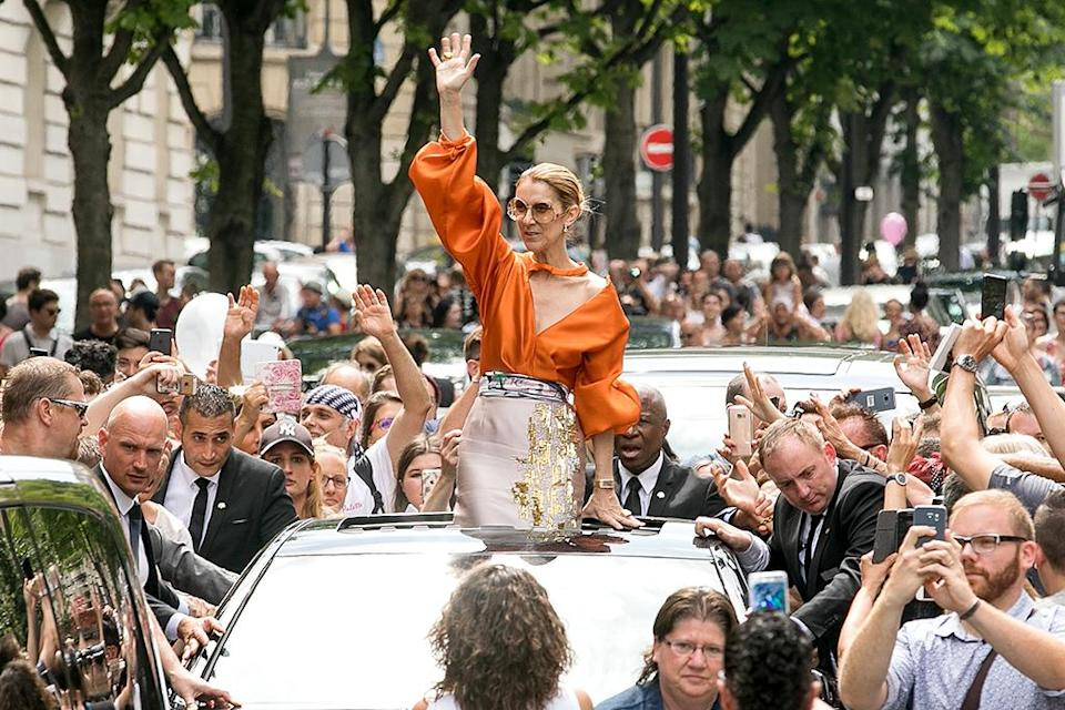 <p>Is that a princess or Céline Dion? Who are we kidding… same thing! The legendary singer waved to her fans while driving down the street in Paris. (Photo: Marc Piasecki/GC Images) </p>