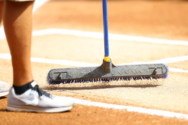 <p>Groundskeeper prepares the field before the game at the Ballpark of the Palm Beaches in West Palm Beach, Fla., on Feb. 26, 2018. (Photo: Gordon Donovan/Yahoo News) </p>