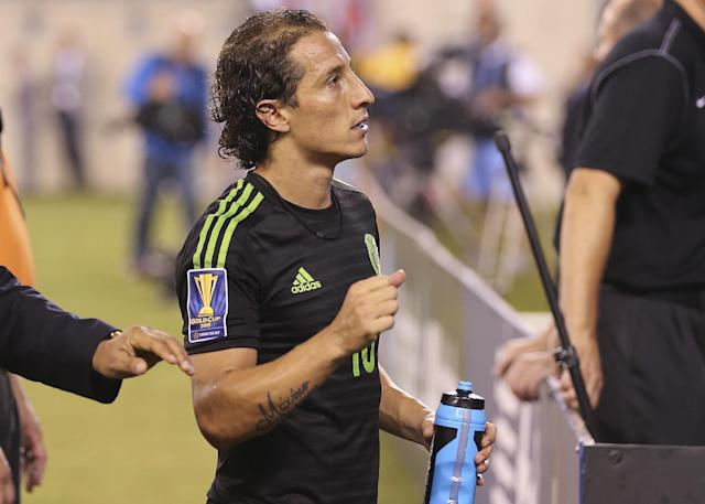 Mexico's Andres Guardado (18) leaves the field after an overtime period of a CONCACAF Gold Cup soccer match against Costa Rica Sunday, July 19, 2015, at MetLife stadium in East Rutherford, N.J. Mexico won 1-0. (AP Photo/Seth Wenig)