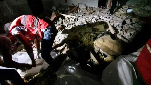 Rescuers search for bodies and survivors under the rubble