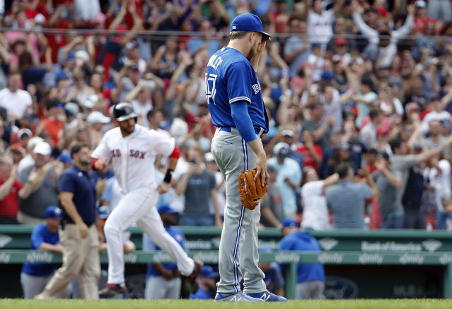 Toronto Blue Jays pitcher Chris Rowley drops his head after giving up the game-winning grand slam to Boston Red Sox' Xander Bogaerts in the 10th inning of a baseball game Saturday, July 14, 2018, in Boston. The Red Sox won 6-2. (AP Photo/Winslow Townson)
