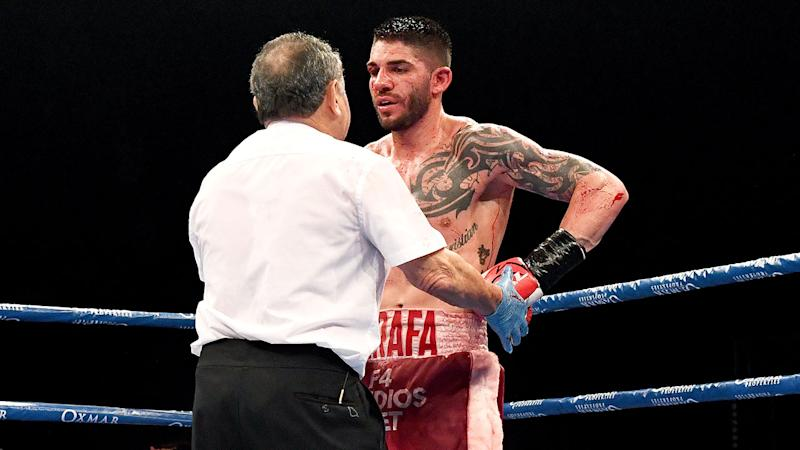 Seen here, Michael Zerafa chats with the referee during his rematch with Jeff Horn.