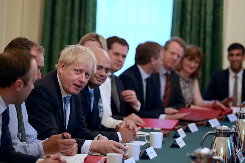 Prime Minister Boris Johnson (third left) holds his first Cabinet meeting at Downing Street in London.