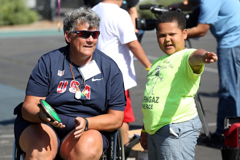 IMAGE DISTRIBUTED FOR SAMSUNG -Paralympian Angela Madsen, left, works with LAUSD students during Ready, Set, Gold! Day sponsored by Samsung at Trinity Street Elementary on Saturday, May 2, 2015 in Los Angeles. (Photo by Matt Sayles/Invision for Samsung/AP Images)