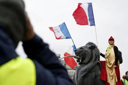 French 'yellow vests' march through Paris, France, denouncing police violence