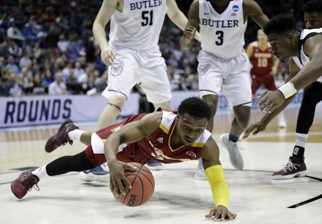 <p>Winthrop's Keon Johnson falls as he chases a loose ball against Butler's Kelan Martin, right, during the second half of an NCAA college basketball tournament first round game Thursday, March 16, 2017, in Milwaukee. (AP Photo/Morry Gash) </p>