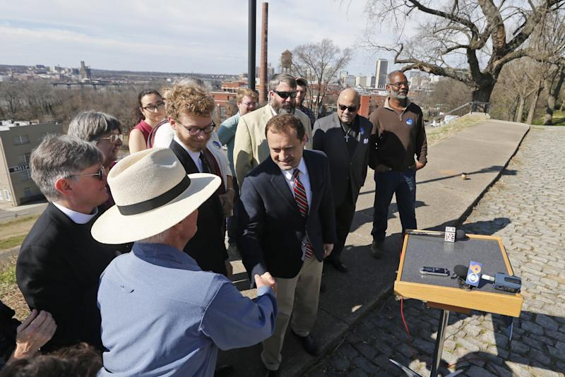 Former congressman Tom Perriello greets supporters as he arrives for a news conference at a park along the James River in Richmond, Va., onFeb. 8.