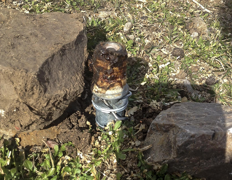 FILE - This Thursday, March 16, 2017, file photo released by the Bannock County Sheriff's Office shows a cyanide device in Pocatello, Idaho, The cyanide device, called M-44, is spring-activated and shoots poison that is meant to kill predators.   Environmental and animal-welfare groups have filed a lawsuit, Tuesday, April 4, 2017, claiming the U.S. government is violating the Endangered Species Act by allowing the use of two predator-killing poisons.  (Bannock County Sheriff's Office via AP)