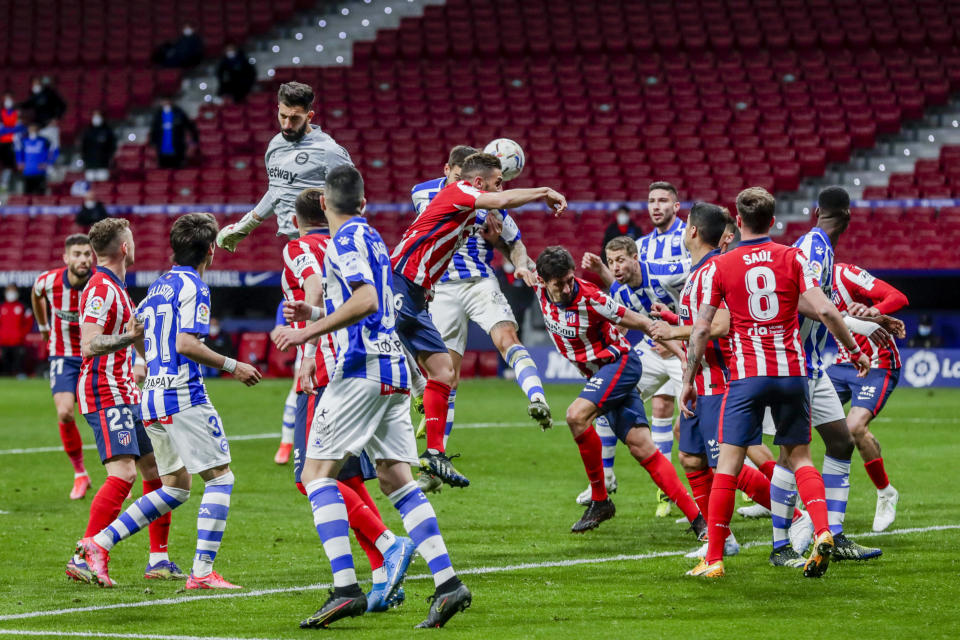 Atletico Madrid and Alaves play during the Spanish La Liga soccer match between Atletico Madrid and Alaves at the Wanda Metropolitano stadium in Madrid, Spain, Sunday, March 21, 2021. (AP Photo/Manu Fernandez)