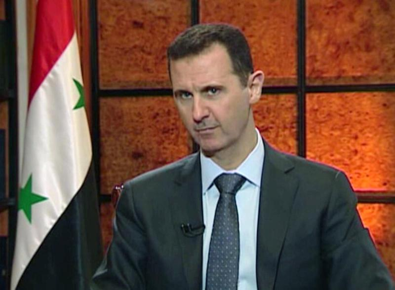 """In this image from video broadcast on Syrian state television Wednesday, April 17, 2013, President Bashar Assad speaks during an interview. Syria's president accused the West on Wednesday of backing al-Qaida in his country's civil war, warning it will pay a price """"in the heart"""" of Europe and the United States as the terror network becomes emboldened. The rare TV interview comes as the embattled president's military is fighting to reverse rebel advances, with a rocket attack killing at least 12 people in a central village on Wednesday. (AP Photo/Syrian State TV via AP video"""