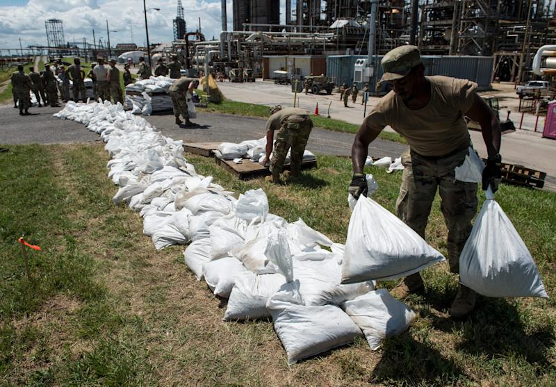 Army National Guard members put down sandbags at Chalmette Refining in New Orleans, La., on Thursday, July 11, 2019.