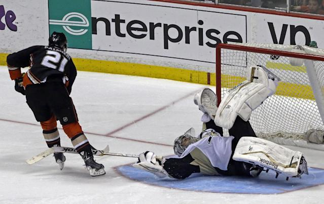 Pittsburgh Penguins goalie Marc-Andre Fleury (29) goes sprawling to block a shot by Anaheim Ducks right winger Kyle Palmieri (21) in a shootout in an NHL hockey game in Anaheim, Calif., Friday, March 7, 2014. The Penguins won the shootout, 3-2. (AP Photo/Reed Saxon)