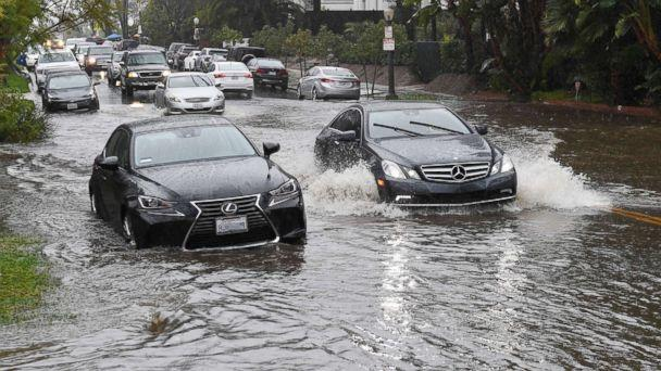 PHOTO: Cars drive through a flooded street after a storm dumped heavy rain on Los Angeles, Feb. 2, 2019. (Mark Ralston/AFP/Getty Images)
