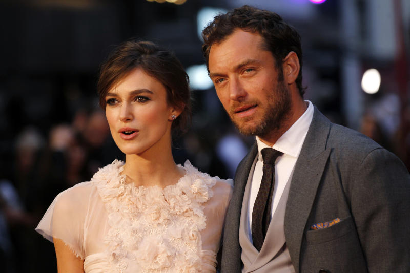 Cast members British actress Keira Knightley and actor Jude Law pose as they arrive for the world premiere of Anna Karenina in London, Tuesday, Sept. 4, 2012. (AP Photo/Sang Tan)