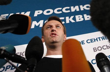 Opposition leader Alexei Navalny speaks to the media at his campaign headquarters after voting closed in a mayoral election in Moscow September 8, 2013. REUTERS/Maxim Shemetov