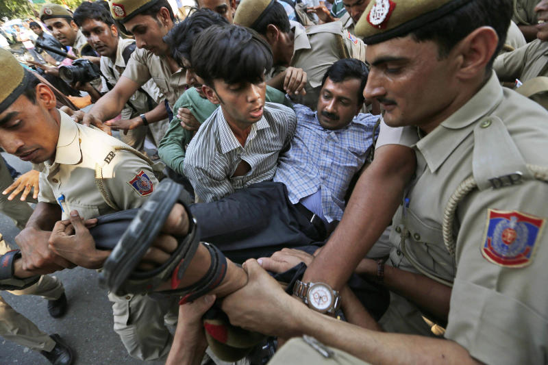 FILE – In this Friday, Oct. 12, 2012 file photo, India Against Corruption activist Arvind Kejriwal is carried away by policemen as he sits with disabled people to protest against alleged embezzlement of government funds meant for the welfare of the disabled, in New Delhi, India. Launching his own political party this month, longtime bureaucrat-turned-activist Kejriwal taps into the disgust of ordinary Indians amid a seemingly unending stream of corruption scandals that have tainted politicians of all stripes over the last few years. (AP Photo/Saurabh Das, File)