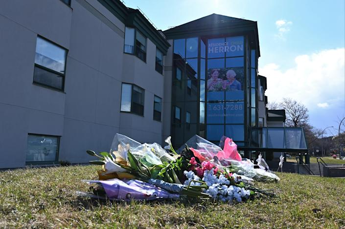 Flowers were left outside Résidence Herron in the spring as it became a focal point in the province's concerning situation within CHSLDs. (Credit: Eric Thomas/AFP via Getty Images)
