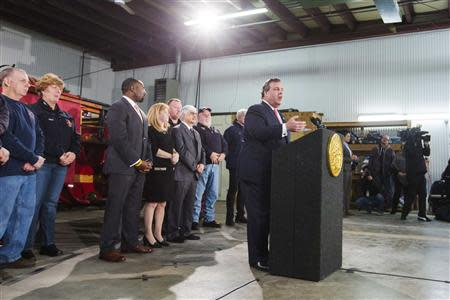 New Jersey Governor Chris Christie speaks to media and homeowners about the ongoing recovery from Hurricane Sandy in Manahawkin, New Jersey January 16, 2014. REUTERS/Lucas Jackson