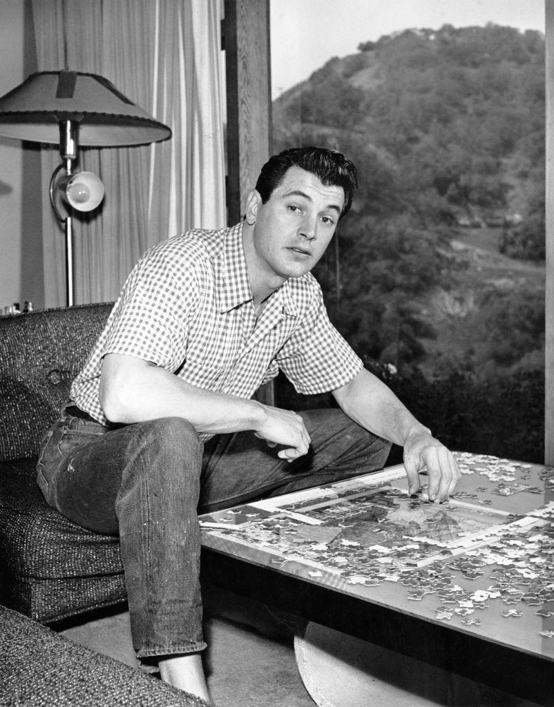 """<p>According to <em>Architectural Digest</em>, Hudson's <a href=""""https://www.architecturaldigest.com/story/rock-hudson-former-home-for-sale"""" rel=""""nofollow noopener"""" target=""""_blank"""" data-ylk=""""slk:real estate portfolio"""" class=""""link rapid-noclick-resp"""">real estate portfolio</a> in the early 1950s consisted of a spacious house located in the Hollywood hills, which he shared with his wife at the time. </p><p>Following their divorce, he traded up for a Spanish-style abode known as """"The Castle"""" in Beverly Hills, where he lived from 1962 until his death in 1985.</p>"""