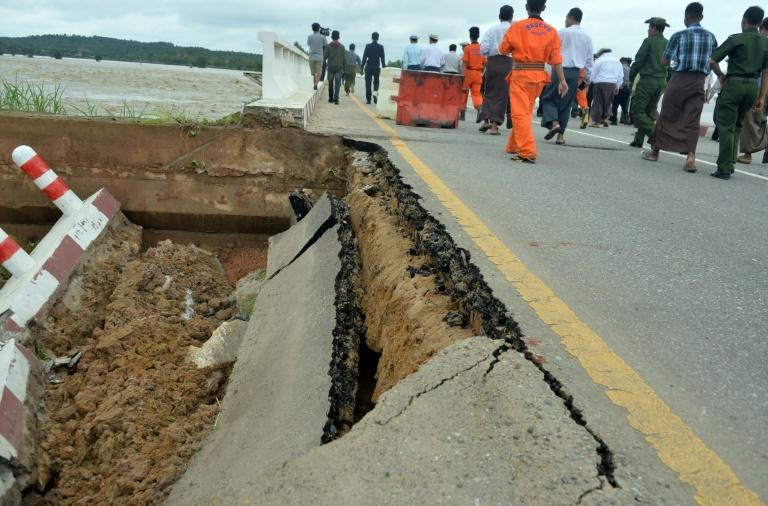 A section of a bridge damaged by rampaging flood waters