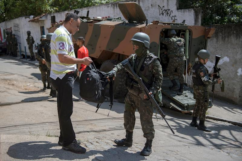 A resident of Morro dos Macacos favela (Monkey's hill shantytown) is searched by a Brazilian Armed Forces soldier during a security operation in the area in Rio de Janeiro, Brazil on October 6, 2017