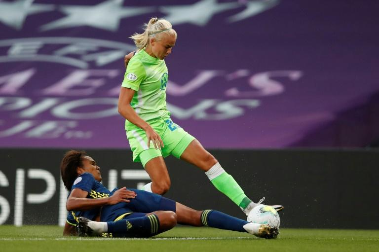 Going toe to toe: Lyon' defender Wendie Renard and Wolfsburg forward met in the Champions League final and are among three women finalists for a FIFA Best award