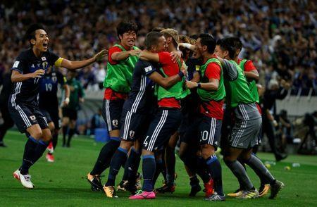 Football Soccer - Japan v Australia - World Cup 2018 Qualifiers - Saitama Stadium 2002, Saitama Japan - August 31, 2017 - Japan's Ideguchi Yosuke (3rd L) celebrates his goal with teammates. REUTERS/Toru Hanai