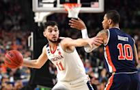 Ty Jerome #11 of the Virginia Cavaliers passes against Samir Doughty #10 of the Auburn Tigers during the second half of the semifinal game in the NCAA Men's Final Four at U.S. Bank Stadium on April 06, 2019 in Minneapolis, Minnesota. (Photo by Josh Duplechian/NCAA Photos via Getty Images)